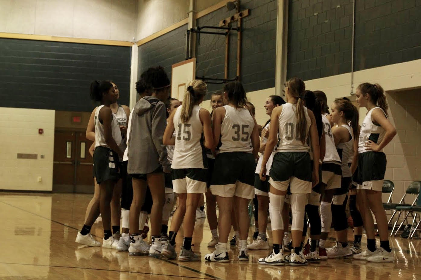 The JV team huddles around seniors Takara Holst and Nicole Leff during a timeout at Fall League game vs. Lake Travis. The teams, Freshman, JV, and Varsity, all came out on top of their Lake Travis games. The younger teams look up to the returning players for support and example during Fall League and even into the season.