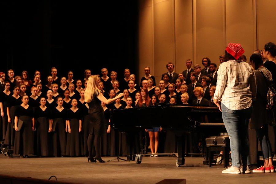 Choir director Lisa Holt conducts