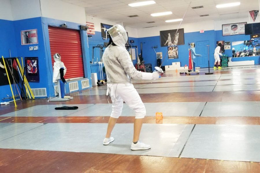 Sophomore Tamara Eslava practices fencing at the Texas Fencing Academy. Eslava began fencing a few months ago after she was inspired by the