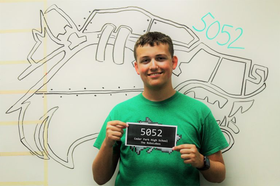 Posing+for+his+robotics+leadership+photo+session%2C+senior+Travis+Weir+has+been+in+Robotics+since+his+freshman+year.+Weir+is+a+member+of+robotics+and+broadcast.+%E2%80%9CMy+favorite+part+of+technology+is+when+I+finally+get+something+working+after+a+lot+of+work%2C%E2%80%9D+Weir+said.+%E2%80%9CThere%27s+nothing+quite+like+the+feeling+of+success+when+something+you%27ve+been+working+on+for+hours+comes+to+life+and+works+exactly+as+it+should.%E2%80%9D+