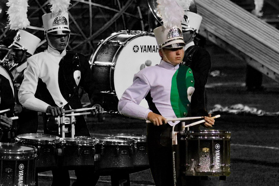 """Hitting the drum, sophomore Chris Masters performs at halftime during the football game against San Angelo. Masters plans to be the drum captain next season. """"I want to be drum captain because past drum captains have taught me a lot about not only drumming, but life in itself,"""" Masters said."""