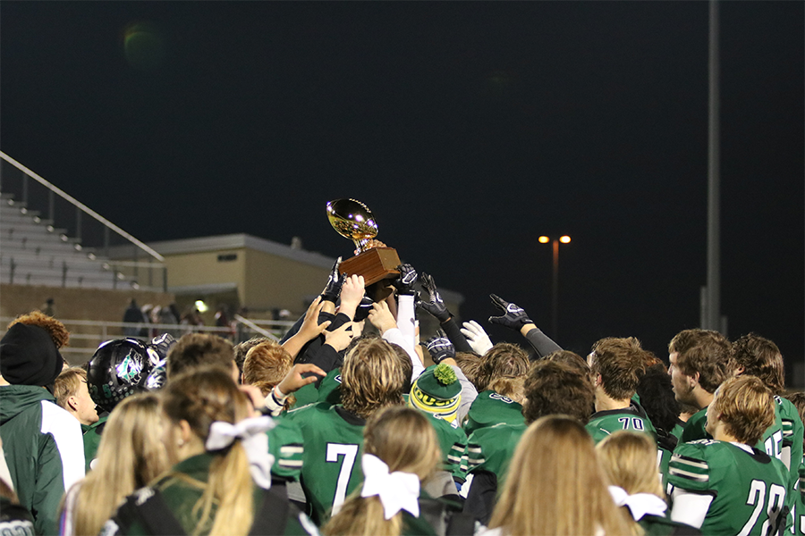 The T-Wolves hoist the district  champions trophy after officially clinching the outright title. The Wolves