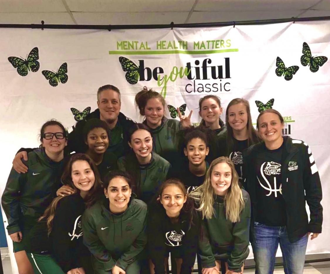 The Lady Wolves Varsity basketball team poses for a picture at the Austin Bowie Be-YOU-Tiful Tournament. The team plans to continue their success at the McDonald's Invitational Tournament this weekend.
