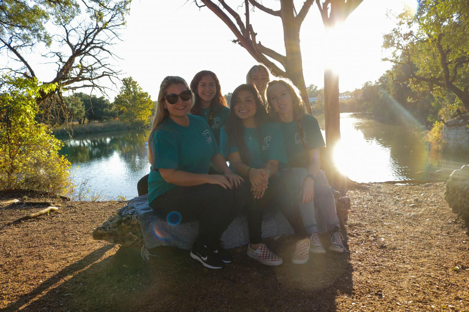 """Photography club officers and sponsor pose at Brushy Creek Park during their community service event. Senior club officer Cally Hall said she found the opportunity very enriching. """"It was rewarding to take the family photos, I enjoyed knowing that I was a part of making sure these families have memories to cherish forever,"""" Hall said. """"I was afraid I would be shy or awkward taking photos of people I don't really know, but it went a lot more smoothly than I anticipated and was actually pretty fun."""""""
