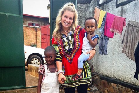 2014 alumna Taylor Lavine poses with children in Africa, where she lived for a month.