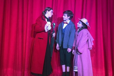 Playing the role of Michael Banks, freshman Ben McDanald performs during his eighth grade year in theatre's production of