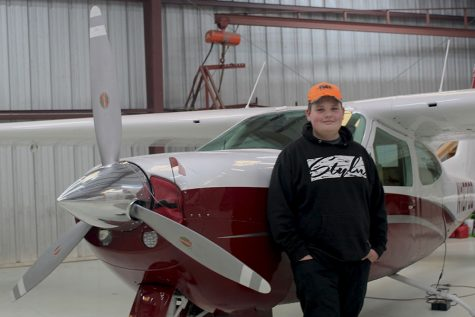 Standing in front of his Cardinal Airplane, Freshman Alex Trebilco reminisces about the good times he's had in it.