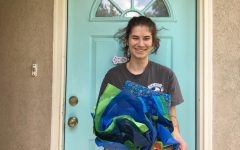 Holding her basket of gifts, senior Sarah Rodriguez thanks her adoption family.