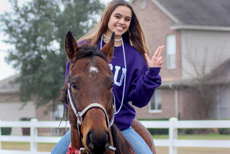 """Holding up the Tarleton State University hand sign, senior Abby Mitchell poses for her senior pictures on her horse, Thirsty. Mitchell's family adopted the horse in January 2019 and then began training him. """"It's always fun to train Thirsty because I get to see him grow,"""" Mitchell said. """"I like getting to see him learn something we've been working on for a while."""""""