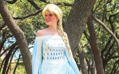 "Wearing one of her three character outfits, junior Katie Smith poses in the Snow Queen costume. Smith first came up with the idea for a party princess business in March and quickly began the process of creating the character costumes and the budget. ""My favorite thing about going to theme parks is interacting with the characters and having conversations with them,"" Smith said. ""I realized that that's something I could bring to the kids right here in Cedar Park so I immediately started planning."""