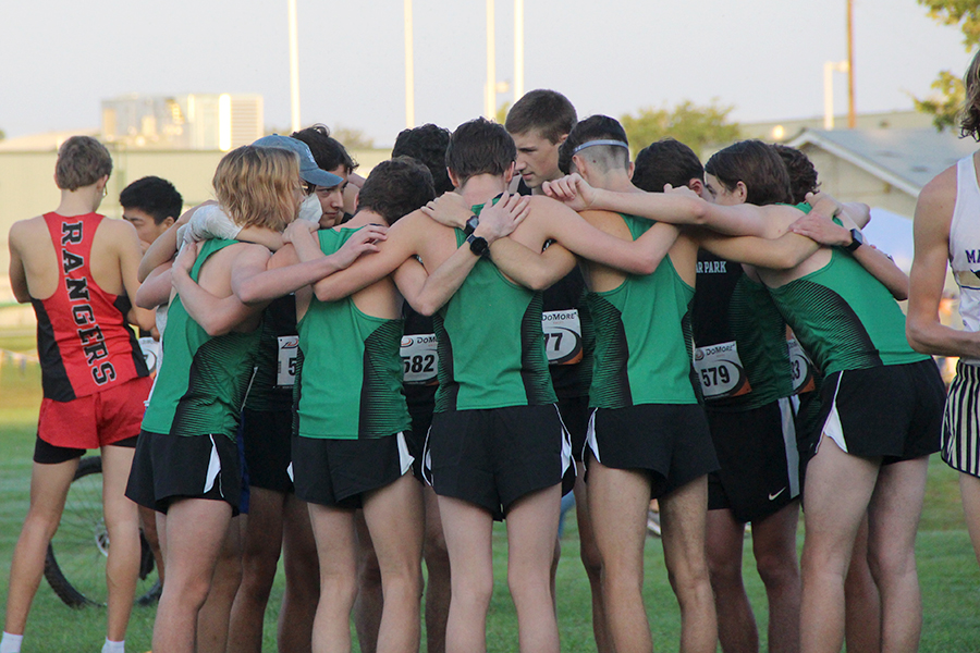 Senior+Garrett+Gray+huddles+with+the+varsity+boys+team+as+they+get+ready+to+race+during+the+Cedar+Park+Invitational+on+Sept.+12.+%22We+are+ready+for+district+and+beyond+later+in+the+season%22+Gray+said.+