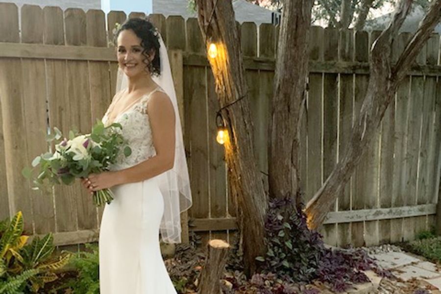 Holding+her+bridal+bouquet%2C+Biology+and+Environmental+studies+teacher+Shawntel+Lopez+poses+during+her+wedding+on+Nov.+14.+A+few+months+in+advanced%2C+Lopez+asked+students+in+Floral+Design+to+create+the+arrangements+for+her+wedding+day.+%E2%80%9CI+always+knew+I+wanted+to+incorporate+students+into+the+wedding+in+some+way%2C%E2%80%9D+Lopez+said.+%E2%80%9CWhen+I+met+Ms.+Butler+and+she+told+me+her+goals+for+the+class%2C+I+jumped+at+the+opportunity+to+have+the+Floral+Design+Class+involved.%22