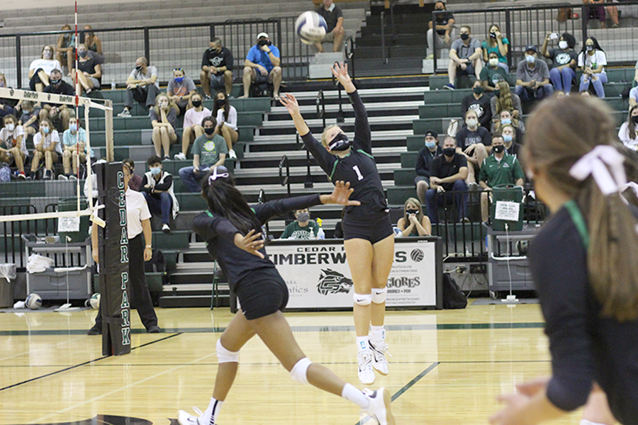 Setting the ball, sophomore Dylan Gilkey jumps in the air to prepare the ball for her teammate. Cedar Park competed against Georgetown on Sept. 29 and won the game with a final score of 3-1. The team was 12-2 in District, but lost to Dripping Springs in the Playoffs.