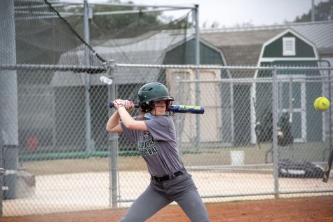 "Preparing to hit the incoming ball, sophomore Mary Lawler looks forward on Feb. 6. As Lawler prepares for another season, she said she hopes the team is able to play their whole season with minimal interruptions. ""I"