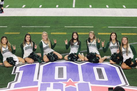 Varsity cheerleaders pose in Cowboy Stadium as they cheer for the football team at the state football championships on Jan. 15, just one day after the they competed in the Spirit Championships in Fort Worth, placing fifth. Senior Captain Emma Vorndran expressed pride at the team