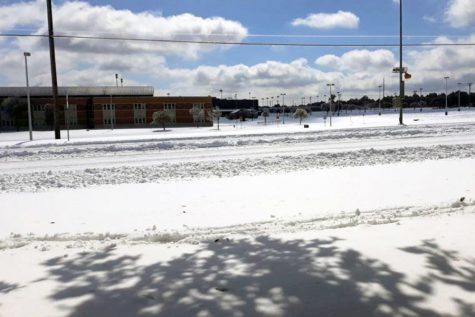 "The CPHS campus covered in snow. On Feb. 14, Leander School District called classes off for a period that lasted over a week as students and teachers suffered power outages. ""The water supply to my house was cut off for two days,"" sophomore Caleb Taylor said. ""Power came back on the midnight of Feb. 16."""