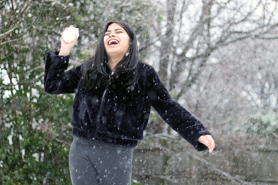 Jumping on her trampoline, freshman Marisol Rios gets ready to launch a snowball on Jan. 10. This was the second time Rios had experienced the snow in her lifetime.