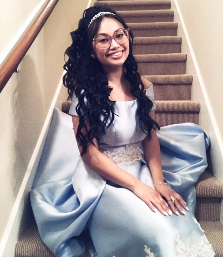 Jasmine+Cooper+sits+on+the+steps+of+her+house%2C+dressed+up+for+the+ACDA+After+Party.+Cooper+was+one+of+the+students+who+participated+in+the+ACDA+and+was+proud+of+the+effort+that+the+team+put+in.+%E2%80%9CFor+the+people+who+wanted+to+view+our+recorded+concert+in-person%2C+%5Bwhich+had%5D+limited+seating%2C++just+choir+students+and+their+families+and+friends+%5Bwere+allowed%5D%2C%E2%80%9D+Cooper+said.+%E2%80%9CWe+had+an+ACDA+watch+party+in+the+PAC+%2Cbecause+us+seniors%2C+who+were+juniors+last+year%2C+didn%E2%80%99t+have+a+prom%2C+and+we+had+a+great+idea+to+make+the+event+formal.+Our+recording+and+video%2C+our+concert%2C+was+amazing.+To+see+our+hard+work+and+our+choir+directors%E2%80%99+efforts+pay+off+was+truly+a+sight.%E2%80%9D