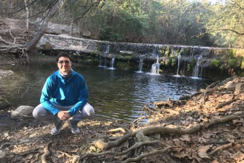 "Hiking with his family and dog on Spicewood Valley Trail, senior Kuba Bard poses by the creek. Him and his family went to this trail in January and enjoy hiking frequently. ""Hiking helps me regain peace and harmony with nature away from the artificial, digital world,"" Bard said."