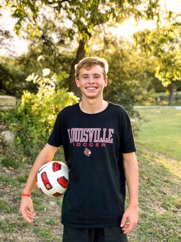 Senior Parker Forbes posing for a soccer photo. After his initial college choice of Appalachian State University removed their soccer program due to COVID-19, Forbes is enrolling in the University of Louisville playing for their Division 1 men