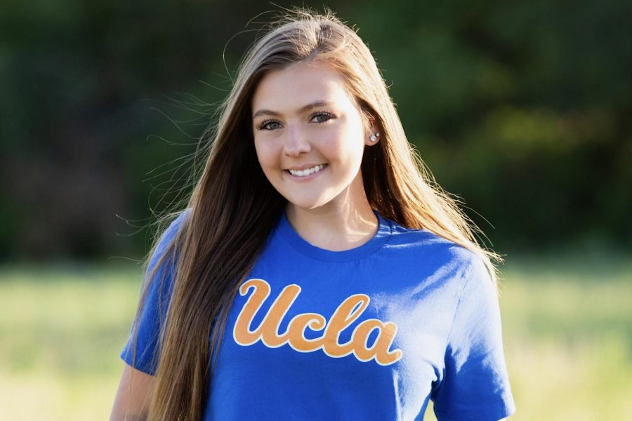 Showing off her commitment to the University of California at Los Angeles, senior Claire O'Keefe smiles proudly. O'Keefe plans to major in neuroscience on a pre-med track and become a psychiatrist or neurologist.