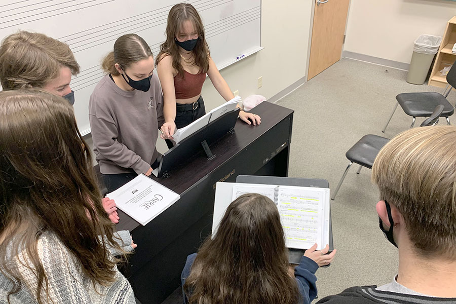 """Working hard, seniors Bella Birdsley, Annika Johnson, Lucy Walter, and sophomores Courtney McDanald, Aidan Cox and James Bailey practice their music for Carrie the Musical at an after-school rehearsal. With only a few weeks left until opening day, cast members are working endlessly to bring Carrie to the stage. """"I'm a little bit nervous, just because it's been like a year and a half since I've done a musical production,"""" senior and lead in the show, Lucy Walter said. """"But I think everyone is really excited to finally get to perform and it'll be surreal when we get back on the stage."""""""