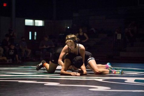 """Fighting for dominance on the mat, sophomore Kylee Foulds competes in one of many wrestling tournaments in 2021. This year's wrestling season will start in early November with the first tournament over Thanksgiving break. """"I'm really excited for this season,"""" Foulds said. """"I'm expecting this season to be more challenging physically because of how short last season was because of COVID-19. It's going to be tough to have to make weight for several months, and having several matches a week, but I'm glad that we have a full season this year."""""""
