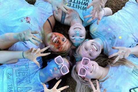 """Beaming with delight, members of YoungLife flaunt their color-stained faces after participating in the Color War, held on Aug. 30. This color war is one of the many events that YoungLife holds in order to encourage everyone to come to their gatherings. """"They want to gather high schoolers from Vista Ridge and Cedar Park, no matter what they believe in, to come together as a community,"""" freshman Emery Taylor said. """"[They want us to] have just like an hour or two to hang out and just talk about what matters to them."""""""