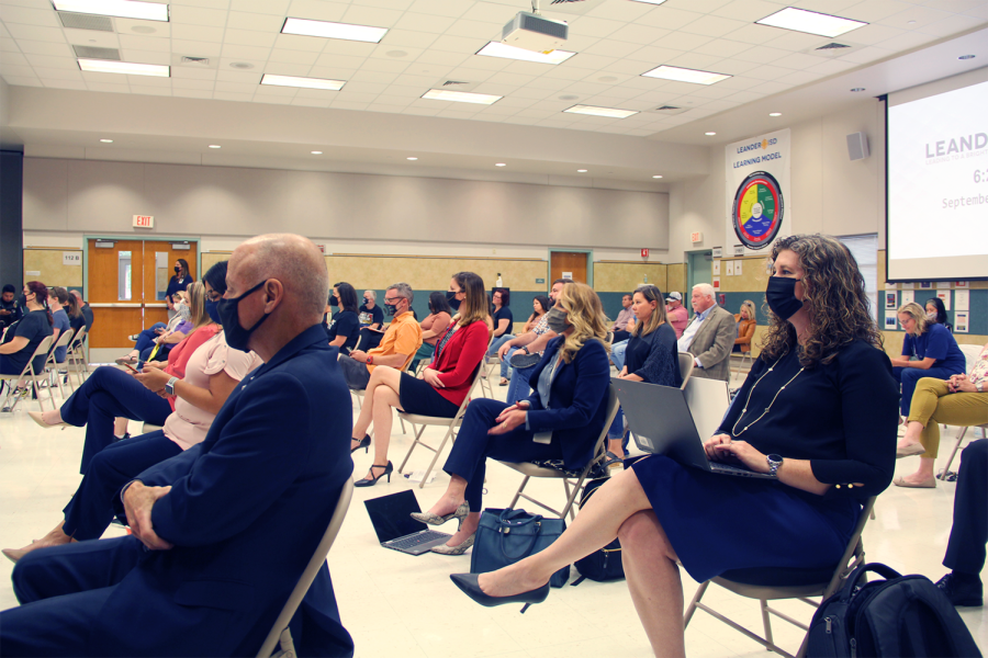 """Watching the Board of Trustee's presentation, parents and teachers listen about the upcoming bond proposal and vote being held on Nov. 2. This vote will include the key issue of how LISD plans to fund their $772 million funding plan with bonds. """"Bond dollars are not part of the district's budget,"""" President of the Board of Trustees Trish Bode said. """"Additionally, bond dollars are not subject to recapture, a state law where LISD receives less money in state aid for every additional dollar in local tax collections. Bond dollars are $1 for $1 investment in our district; the state doesn't remove aid based on collections for debt service."""